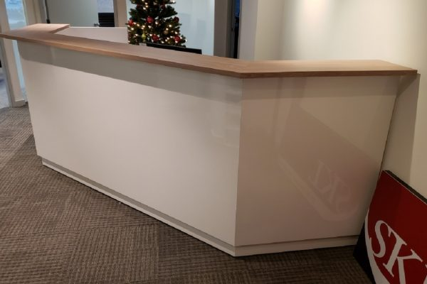 Laminate Reception Desk Featuring A Veneer Transaction Top