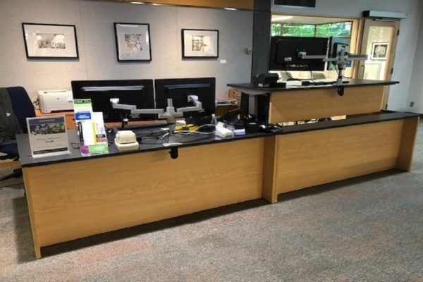 Dual Library Reception Desks With Height Adjustable Section